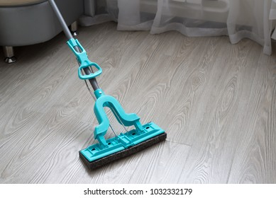 blue mop on laminate background in room