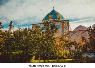 Blue mosque behind park. Elegant islamic masjid building. Travel to Armenia, Caucasus. Touristic architecture landmark. Sightseeing in Yerevan. City tour. Tourism industry. Religious concept