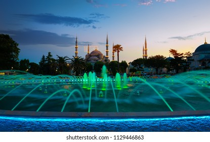 Blue Mosque illuminated at evening in Istanbul, Turkey. Inscription on a mosque is translated as On him is a soul of everyone
