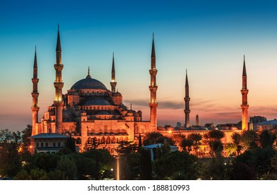Blue Mosque in Istanbul, with lantern light on blue sky background at sunset