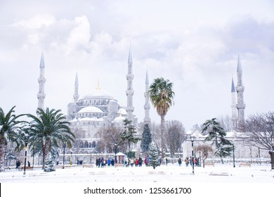 The blue mosque (Sultanahmet mosque) in winter day with snow in Istanbul,Turkey. Tourist group walk around Turkish landmarks.