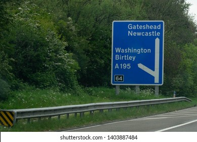Blue Motorway sign directing drivers off the A1 towards Gateshead, Newcastle, Washington and Birtley in County Durham, North East. British motorway sig