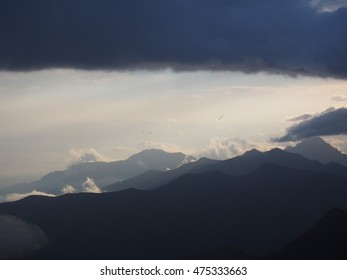 blue mountain ranges in the haze. clouds. caucasus