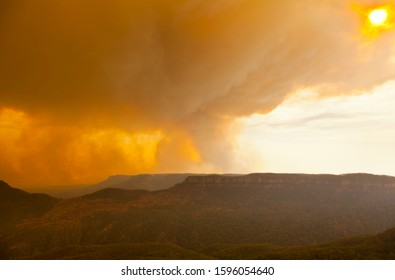 The Blue Mountains, New South Wales / Australia - December 21st 2019: As the wind changes the Ruined Castle bush fire smoke arrives in the Katoomba to block out the sun.