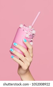 Blue Nails. Woman With Soda Can In Hands On Pink Background. Close Up Of Female Hands WIth Bright Blue Manicure Holding Pink Soda Can With Beads. Nails Design. High Quality Image.