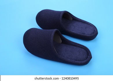 Blue navy house shoes on blue pastel background