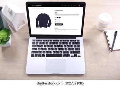 Blue navy sweater on ecommerce wesite