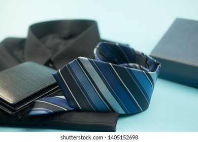 Blue necktie stripe and blue wallet on blue background. Happy father's day and international men's day concepts