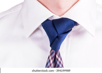 Blue Necktie with Trinity Tie Knot on a White Shirt