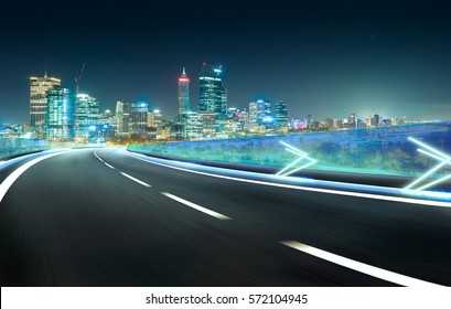Blue neon light highway overpass motion blur with city  skyline background , night scene .