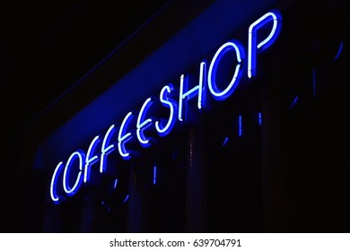 A blue neon sign of a Coffeeshop (coffee shop) - in Amsterdam, Holland