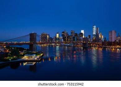 Blue New York panorama with Lower Manhattan and Brooklyn bridge