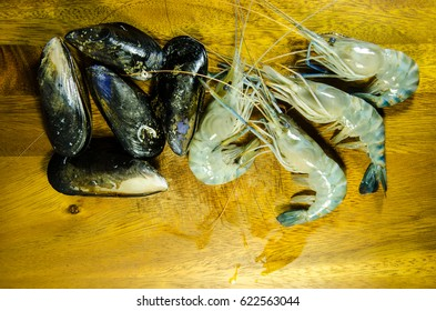 Blue New Zealand mussels and shrimp on the Wood background.