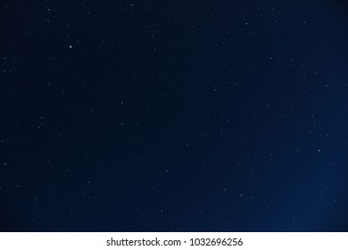 A blue night sky full of stars