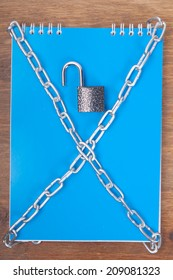 Blue notebook, tied with chains with lock, the concept of information security