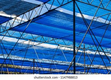 Blue nylon shading net on steel pipe for background
