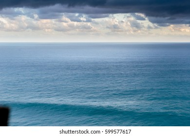Blue ocean with clouds