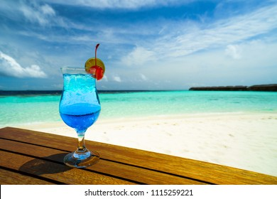 Blue ocean, cocktail on the beach