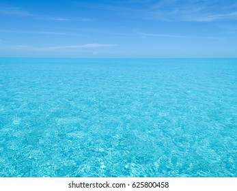 Blue ocean water horizon over Bimini great sand bank, in Bahamas.