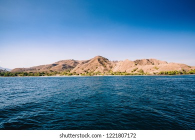 Blue ocean water and view of island of Komodo in Indonesia