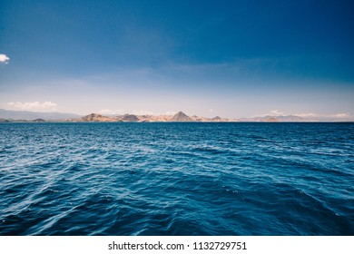 Blue ocean waters overlooking an island
