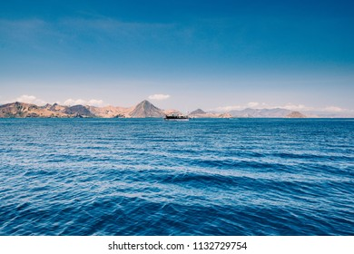 Blue ocean waters overlooking an island and boat