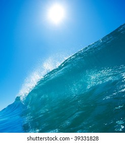 Blue Ocean Wave with Sun and Blue Sky