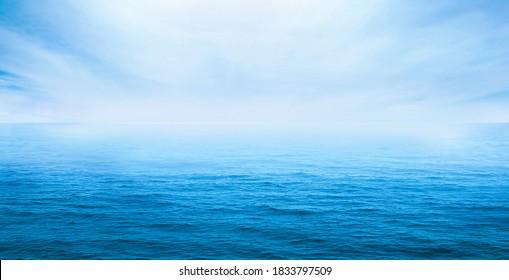 blue ocean waves with blue sky open light - Shutterstock ID 1833797509