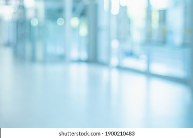 BLUE OFFICE BACKGROUND WITH WINDOW LIGHT REFLECTIONS AND CITY VIEW