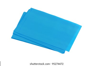 Blue Oil absorbing blotting sheets to remove excess oil on oily face, isolated on white background