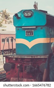 A blue old retro train stands on the tracks of a railway station in Galle Sri Lanka