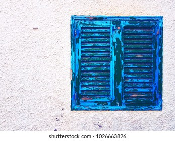 blue old window on a white wall background. vintage. abstraction. wallpaper