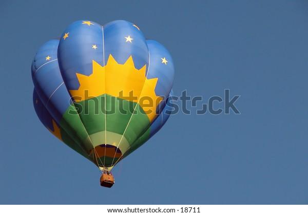 Blue On Blue:  Hot air balloon, from First Annual Hugo Oklahoma Balloon Festival, taking flight