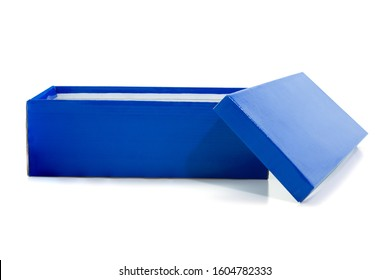 Blue open shoe box isolated on white background. Include clipping path in both objects.
