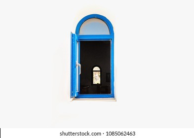 Blue open window of one of buildings