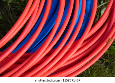 blue and orange fiber cables on a construction site