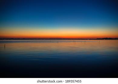 Blue and orange gradation of sunset on the lake Kasumigaura