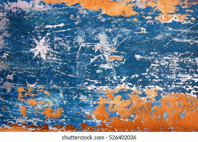 Blue and orange scratched metal background texture