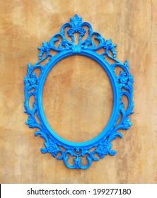 blue oval vintage frame on concrete wall