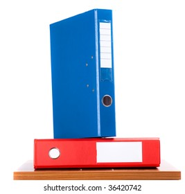 Blue over red folders