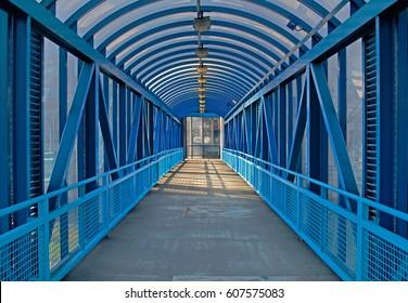 Blue overhead pedestrian bridge in the city