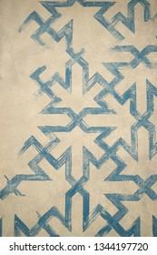 blue paint geometrical pattern on cream background retro
