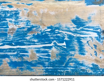 blue paint on wood with scratch
