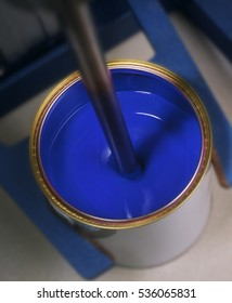 BLUE PAINT IN TIN ON MIXING MACHINE