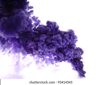 blue paint in the water as a smoke on white background