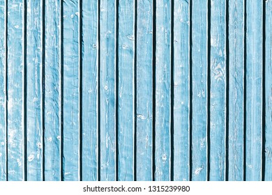 Blue paint wooden board made with parallel desks. Rustic grunge wood texture with dry peeling paint and scratches.