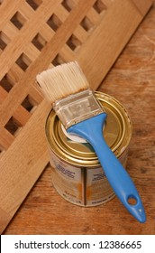 Blue paintbrush on a can ready for painting