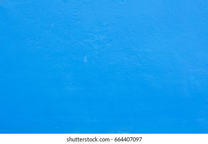 Blue painted cement wall background