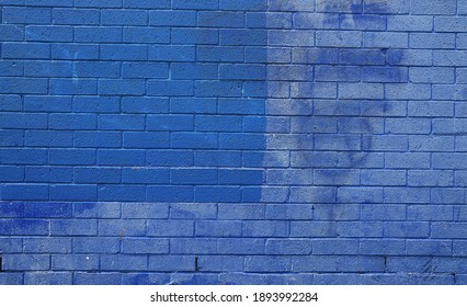 Blue painted discoloured stained weathered exterior brick wall texture
