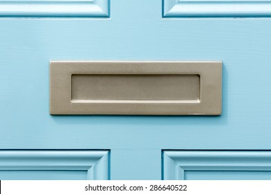 Blue painted door letterbox conceptual image closeup